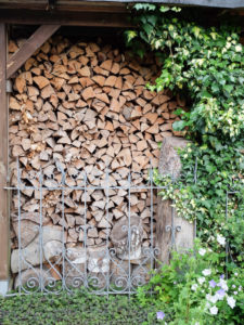 Firewood stacked on the house wall
