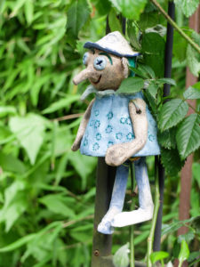 Fairytale figure with a long clay nose as a garden decoration