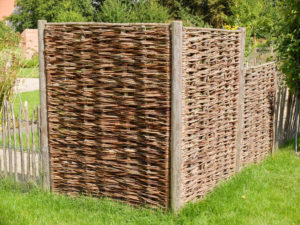 Braided wicker fence as a privacy screen