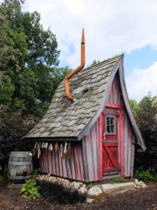 Leaning wooden witch house in the garden