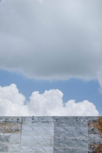 Detail of an empty billboard under cloudy sky
