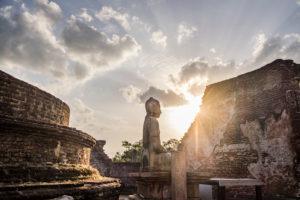 Buddha statue in sunset in a ruin of Sri Lanka's old capital, Polonnaruwa