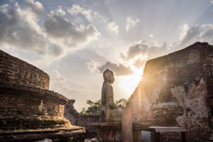 Buddha statue in sunset in a ruin of Sri Lanka's old capital, Polonnaruwa