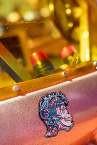 Detail of a colorful skull sticker on an old machine