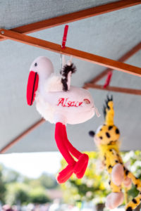 Stork soft toy hangs on a parasol for sale