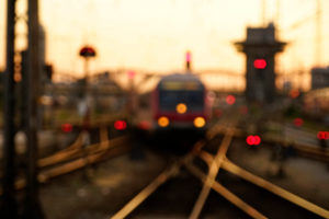 Germany, Bavaria, Munich, central station, railway track with crossing, train, evening mood, out of focus, blurred