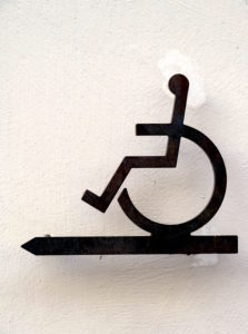 Wheelchair users, metal signs, Sign post for handicapped entrance at a church in Rosenheim, Upper Bavaria, Bavaria, Germany