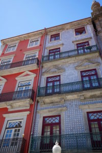 Europe, Portugal, North region, Porto, two town houses, red facade and facade with blue azulejos, tiles