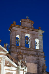 Europe, Portugal, Alentejo region, Evora, Igreja da Graca, Graca church, bell tower, in the evening, illuminated