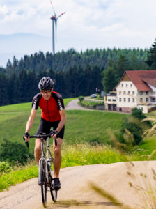 Racing cyclist on narrow mountain road in the Middle Black Forest, Freiamt municipality, Baden-Württemberg