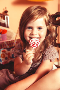 Blond haired Party Girl enjoys licking on a lolly