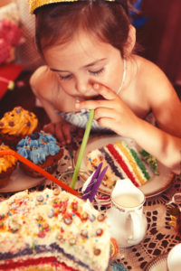 Party Girl enjoys delicious rainbow cake