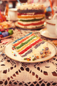 Rainbow Layer Cake on a Kids Party Table with decoration