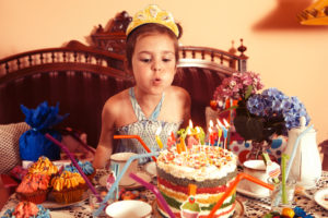 Party Girl blows out candles on her birthday cake