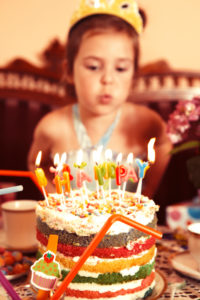 Party Girl blows out candle on her birthday cake