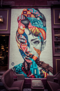 Colorfull Wall painting of Audrey Hepburn, Italian restaurant, Little Italy, Manhattan, New York, USA