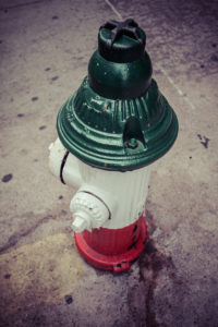 Water Hydrant in italian flag colors, Little Italy, Manhattan, New York, USA