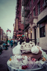 Garbage Dump, Streetview with America Flag and pedestrians in Little Italy, Manhattan, New York, USA