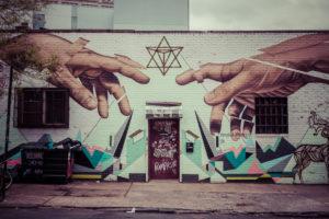 Graffiti of Michelangeloñ¥s God and Adamñ¥s hands in Williamsburg, Brooklyn, New York, USA