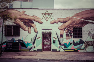 Graffiti of Michelangeloñ¥s God and Adamñ¥s hands in Williamsburg, Brooklyn, New York, USA