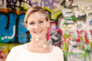 bachelorette party, young woman looking at camera, soap bubbles, portrait
