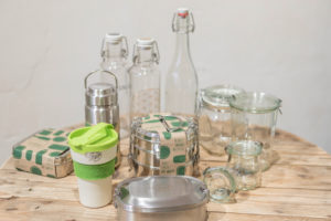 Reusable glass bottles and lunchboxes from the unpackaged 'Stückgut' shop, Altona, Hamburg, Germany