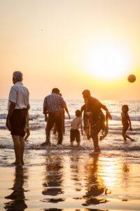 Locals on Juhu Beach in the sunset, Juhu, Mumbai, Maharashtra State, India