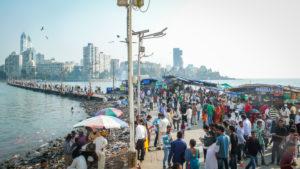 Street scene in front of skyline, Mumbai, Maharashtra state, India