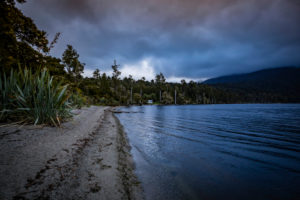 Sunset on the shores of Lake Brunner, South Island New Zealand