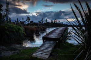 Evening mood and boardwalk on Lake Brunner, South Island New Zealand