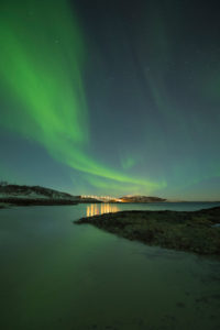 Europe, Norway, Troms, dancing Northern Lights over Kvaløya
