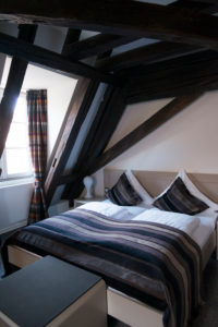 Double bed in room with half-timbered