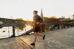 Sporty man jogging in the town, Frankfurt on the Main, Hessen, Germany