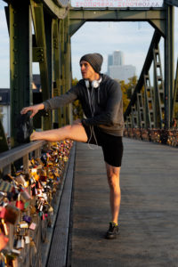 Sporty man stretching in the town, Frankfurt on the Main, Hessen, Germany