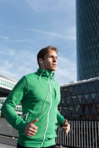 Sporty man jogging in the town, Frankfurt on the Main, Hessen,