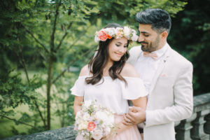 Young bridal couple, happy, in love, outside, half-portrait