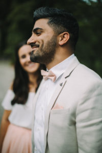 Young bridal couple, happy, in love, man smiling, profile, outside, portrait