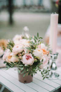 Table outdoors, bridal bouquet, candles, stilllife