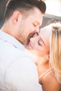 Young couple, happy, in love, tenderness, kiss, portrait, outside