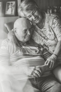 Happy older couple at home, man in the wheel chair, s/w