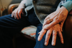 Hands old married couple with wedding ring