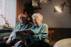 older couple, reading newspaper