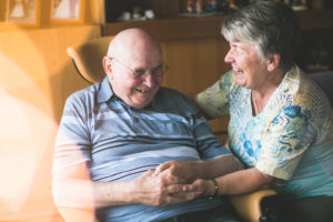 Laughing older couple in domestic environment