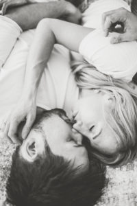 Young couple in love at home in the bed, half portrait, b/w