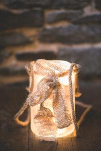 Burning lantern with jute cord, close up