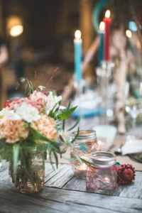Covered table at Indian wedding in a barn,