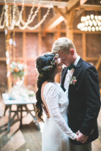 Bride and groom at wedding celebration in a barn