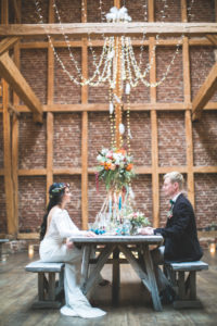 Bride and groom at wedding celebration in barn