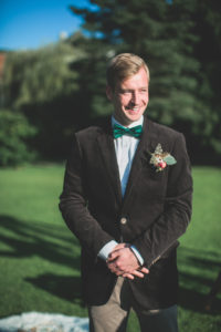 Bridegroom at wedding ceremony outside, half portrait
