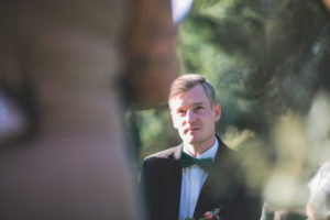 Bridegroom at wedding ceremony outside, portrait